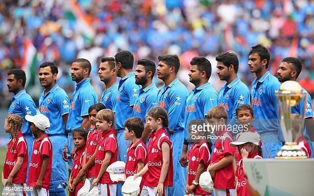 The Indian team line up for the national anthem during the 2015 ICC Cricket World Cup match between South Africa and India at Melbourne Cricket...