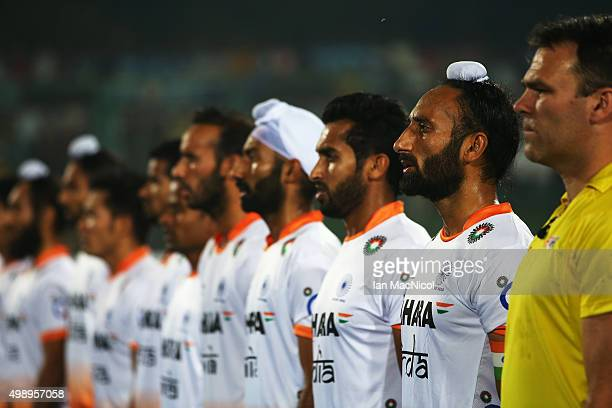 The Indian team sing their national anthem during the match between Argentina and India on day one of The Hero Hockey League World Final at the...