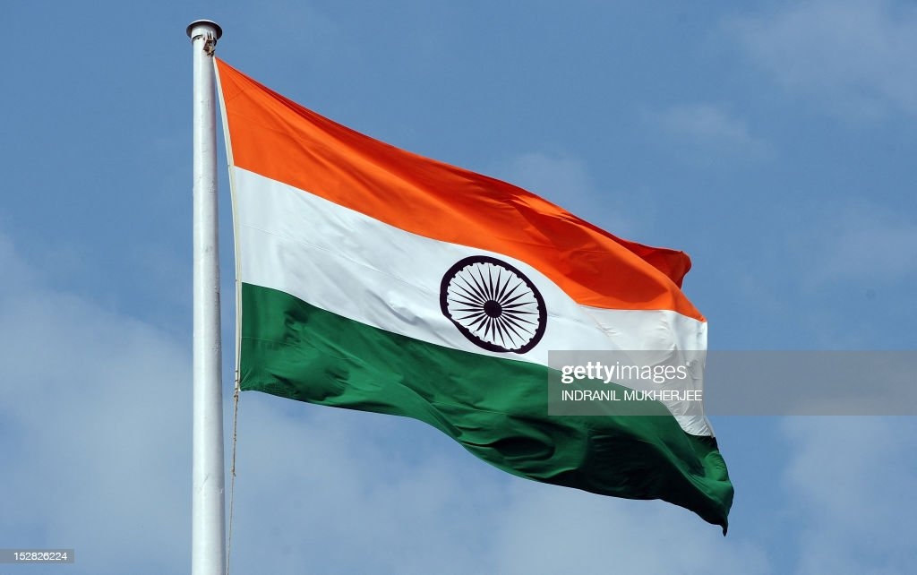The Indian tricolour national flag is seen flying above the Mantralaya state secretariat building in Mumbai on September 27, 2012. AFP PHOTO/ INDRANIL MUKHERJEE