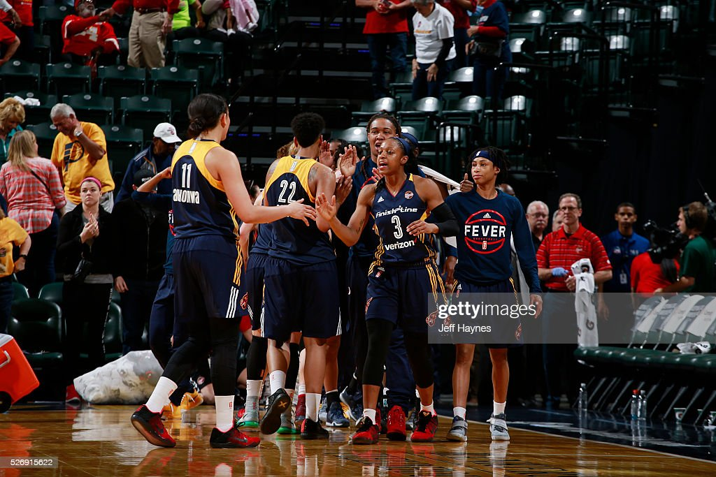 The Indiana Fever celebrate during a preseason game against the Dallas Wings on May 1, 2016 at Bankers Life Fieldhouse in Indianapolis, Indiana.