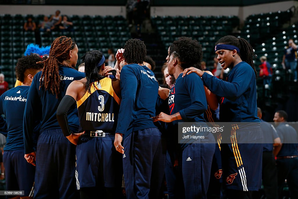 The Indiana Fever huddle during a preseason game against the Dallas Wings on May 1, 2016 at Bankers Life Fieldhouse in Indianapolis, Indiana.