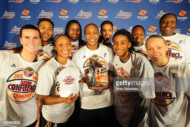 The Indiana Fever team poses for a photo Back Row Eriana Larkins Sasha Goodlett Tammy SuttonBrown Karima Christmas Jessica Davenport Front Row...