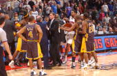 The Indiana Pacers and the Detroit Pistons mix it up in a scuffle on November 19 2004 during their game at the Palace of Auburn Hills in Auburn Hills...