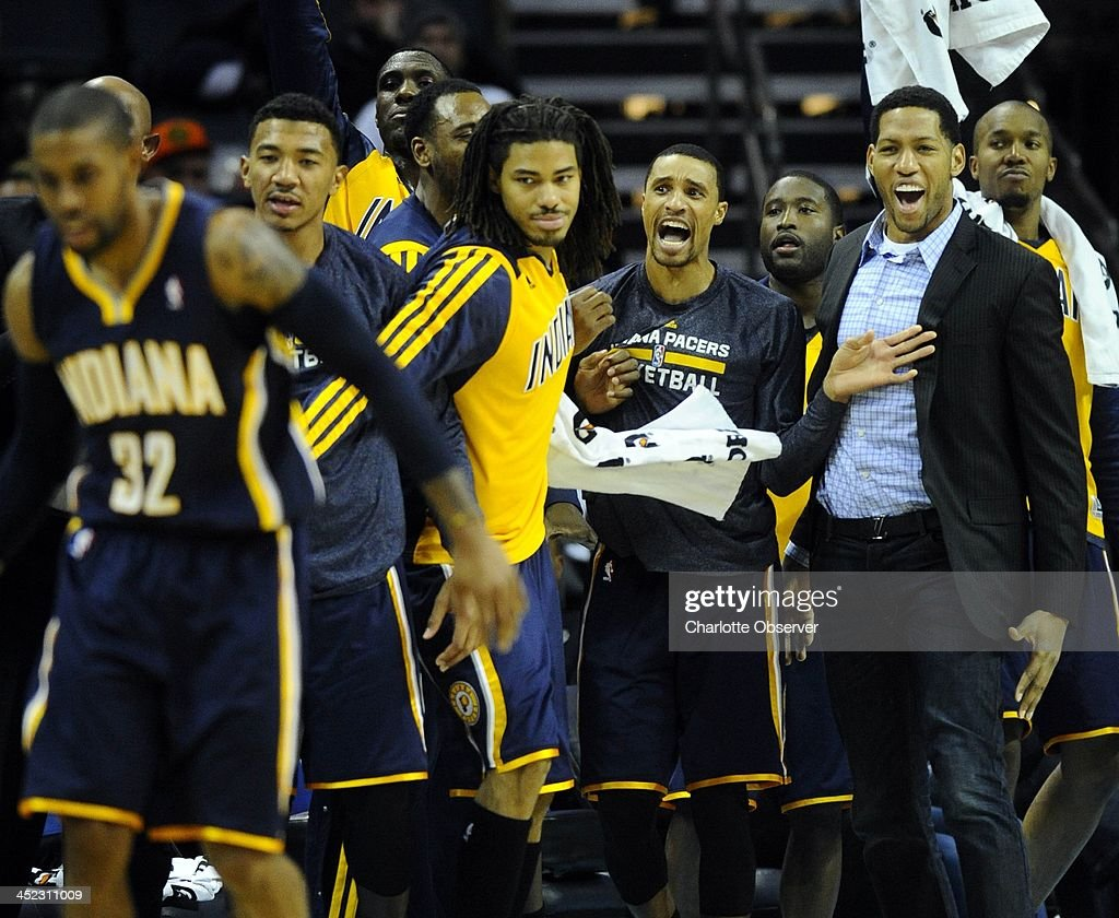 The Indiana Pacers bench celebrates C.J. Watson's (32) 3-pointer against the Charlotte Bobcats in the second half at Time Warner Cable Arena in Charlotte, N.C., on Wednesday, Nov. 27, 2013. Indiana won, 99-74.