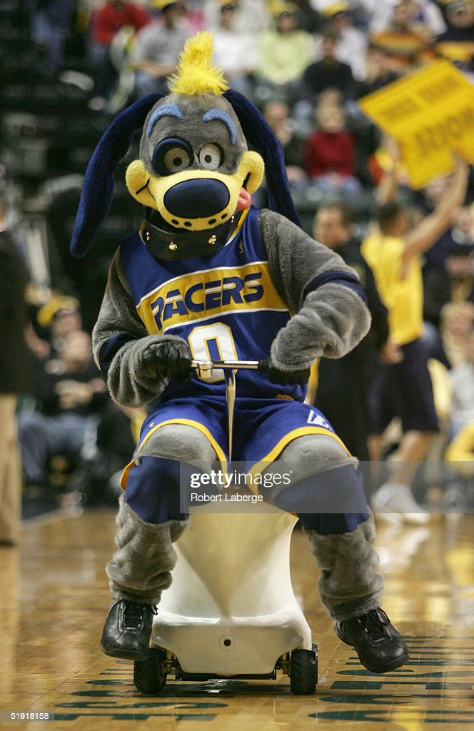 The Indiana Pacers mascot Bowser the Dog drives a toliet around during a break from the game against the Detroit Pistons on December 25 2004 at...