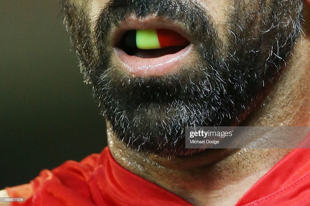 The indigenous mouthguard of <a gi-track='captionPersonalityLinkClicked' href=/galleries/search?phrase=Adam+Goodes&family=editorial&specificpeople=206473 ng-click='$event.stopPropagation()'>Adam Goodes</a> of the Swans is seen during the round 14 AFL match between the Richmond Tigers and the Sydney Swans at Melbourne Cricket Ground on June 20, 2014 in Melbourne, Australia.