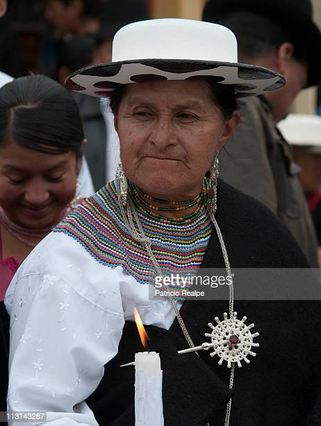 The indigenous people take part in the traditional ceremony of Descent of the Angel during Easter celebrations on April 24 2011 in Saraguro Ecuador
