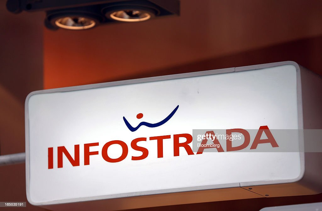 The Infostrada logo sits on display in side a Wind SpA mobile phone store, owned by VimpelCom Ltd., in Rome, Italy, on Thursday, April 4, 2013. Italy's state-owned postal service and Wind SpA, the country's third-largest mobile-phone company, are discussing a possible venture with Wind's fixed-line network Infostrada, Poste Italiane SpA Chief Executive Officer Massimo Sarmi said. Photographer: Alessia Pierdomenico/Bloomberg via Getty Images