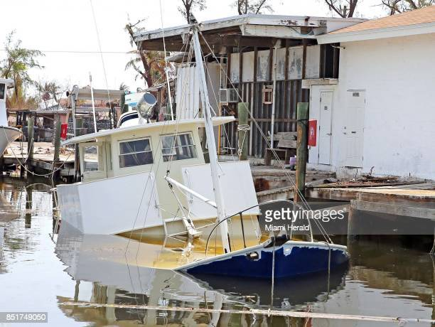 The Ingram family's liveaboard boat sunk at a dock in Marathon Florida Keys on September 20 2017 Brad and Syria Ingram with their daughter Luna are...