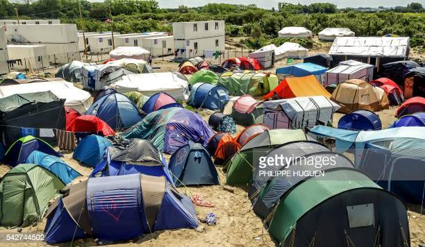 The initials of the United Kingdom UK are seen tagged into a heartshape logo onto some tents of migrants inside the 'Jungle' camp for migrants and...