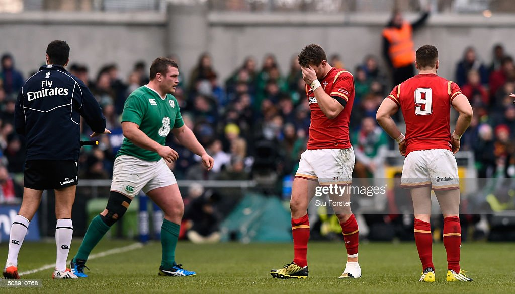 The injured <a gi-track='captionPersonalityLinkClicked' href=/galleries/search?phrase=Dan+Biggar&family=editorial&specificpeople=5607224 ng-click='$event.stopPropagation()'>Dan Biggar</a> of Wales leaves the pitch midway through the first half during the RBS Six Nations match between Ireland and Wales at the Aviva Stadium on February 7, 2016 in Dublin, Ireland.