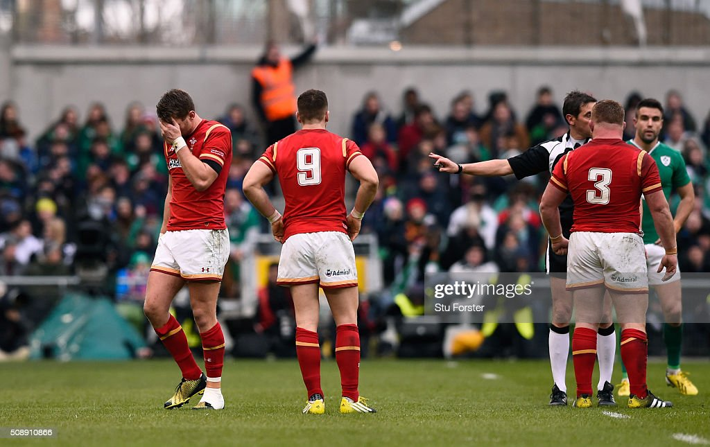 The injured Dan Biggar of Wales leaves the pitch midway through the first half during the RBS Six Nations match between Ireland and Wales at the Aviva Stadium on February 7, 2016 in Dublin, Ireland.