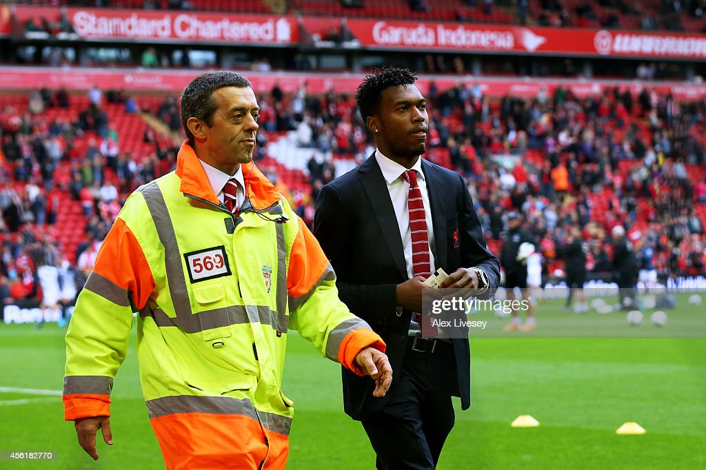 The injured <a gi-track='captionPersonalityLinkClicked' href=/galleries/search?phrase=Daniel+Sturridge&family=editorial&specificpeople=677270 ng-click='$event.stopPropagation()'>Daniel Sturridge</a> of Liverpool takes his seat prior to kickoff during the Barclays Premier League match between Liverpool and Everton at Anfield on September 27, 2014 in Liverpool, England.