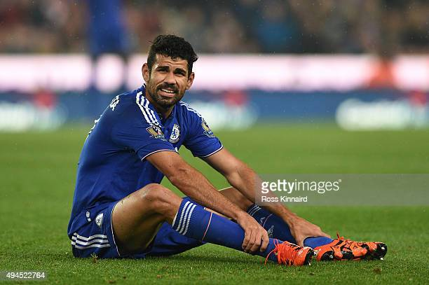 The injured Diego Costa of Chelsea looks on prior to leaving the pitch due to injury during the Capital One Cup fourth round match between Stoke City...