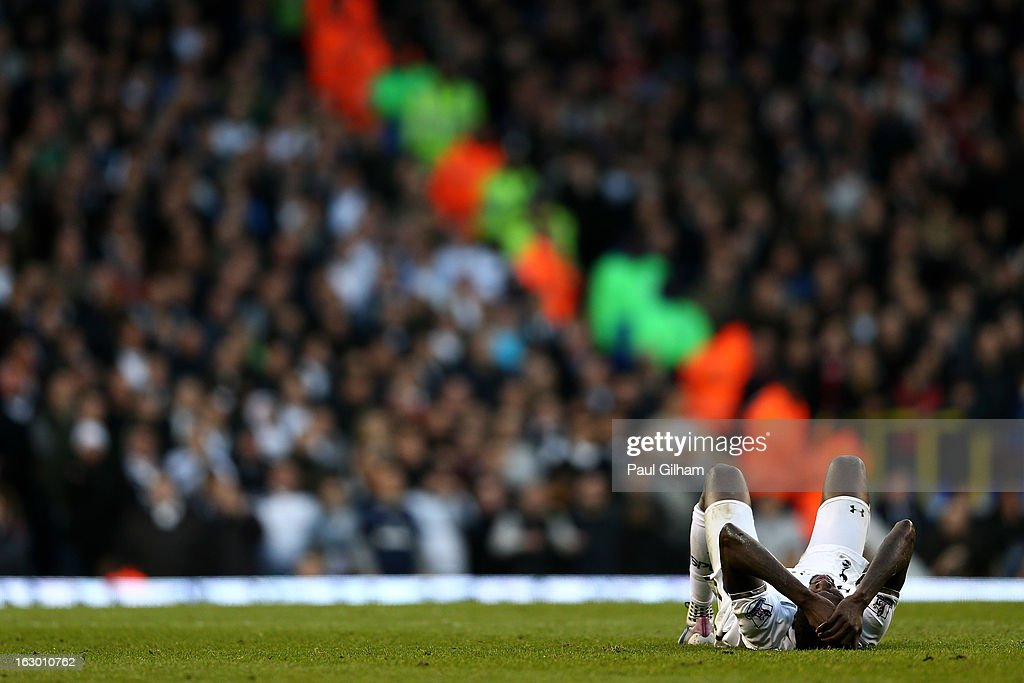 The injured Emmanuel Abebayor of Spurs lies on the pitch during the Barclays Premier League match between Tottenham Hotspur and Arsenal FC at White Hart Lane on March 3, 2013 in London, England.