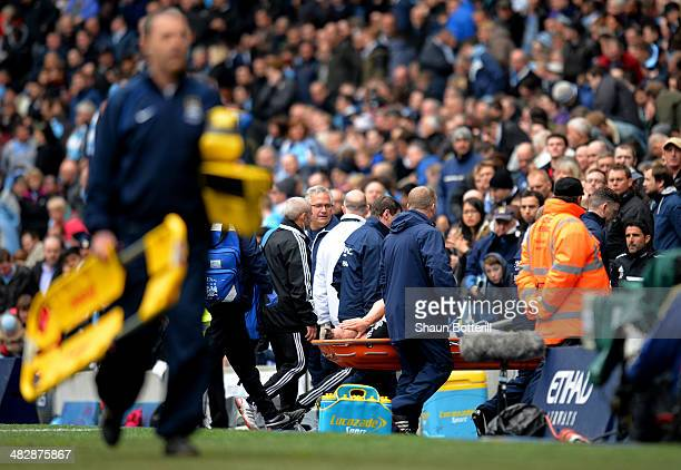 The injured Jay Rodriguez of Southampton is stretchered off the pitch during the Barclays Premier League match between Manchester City and...