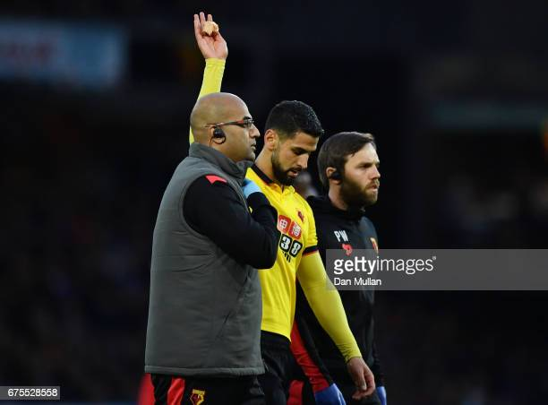 The injured Miguel Angel Britos of Watford leaves the field during the Premier League match between Watford and Liverpool at Vicarage Road on May 1...