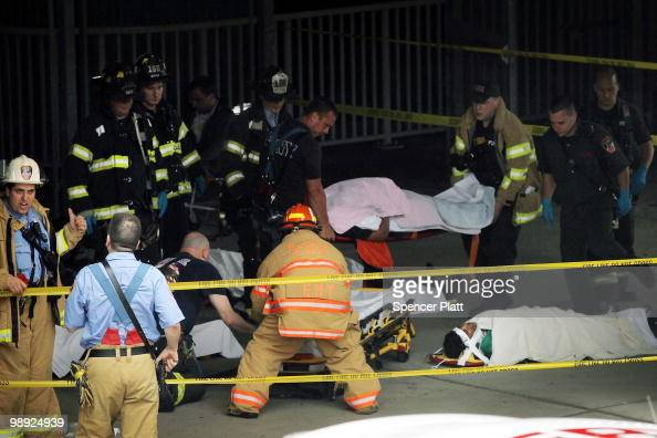 The injured wait to be placed on an ambulance following the crash of the Staten Island Ferry into a dock in the city's borough of Staten Island on...
