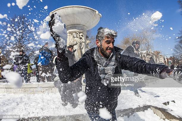 The inner fountain retaliates after being assaulted from outsiders as hundreds of people gather for a massive snowball fight at Dupont Circle in...