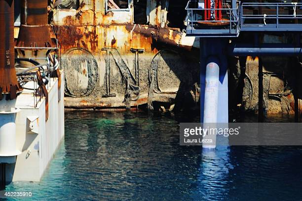 The inscription Costa Concordia is visible from the submerged starboard side of the wrecked cruise ship as it sits in the water after the first stage...