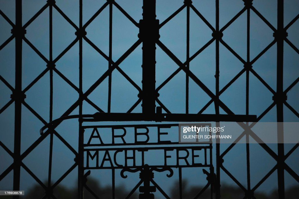 The inscription 'Work sets free' (Arbeit macht frei) at the entrance gate of the former concentration camp in Dachau, southern Germany is pictured on August 18, 2013. German chancellor Angela Merkel will travel to the memorial near the southern city of Munich on August 20, 2013. More than 200,000 Jews, gays, Roma, political opponents, the disabled and prisoners of war were imprisoned in Dachau during World War II.