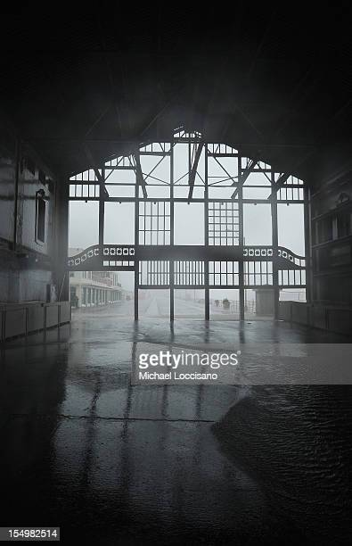 The inside of a dilapidated building on the boardwalk begins to flood from Hurricane Sandy rains on October 29 2012 in Asbury Park New Jersey The...