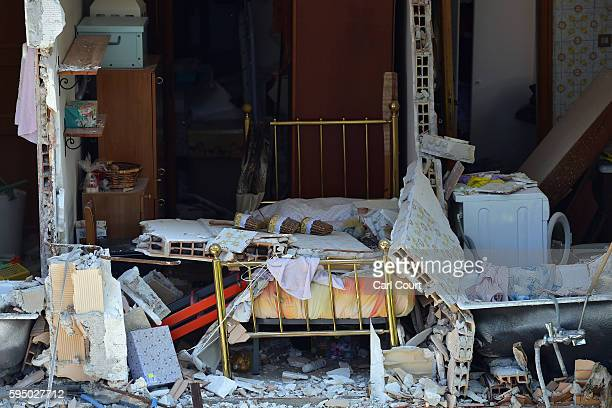 The inside of a home is seen after a building partly collapsed during an earthquake on August 25 2016 in Amatrice Italy The death toll in the 62...