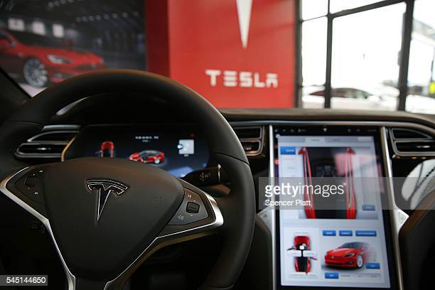 The inside of a Tesla vehicle is viewed as it sits parked in a new Tesla showroom and service center in Red Hook Brooklyn on July 5 2016 in New York...