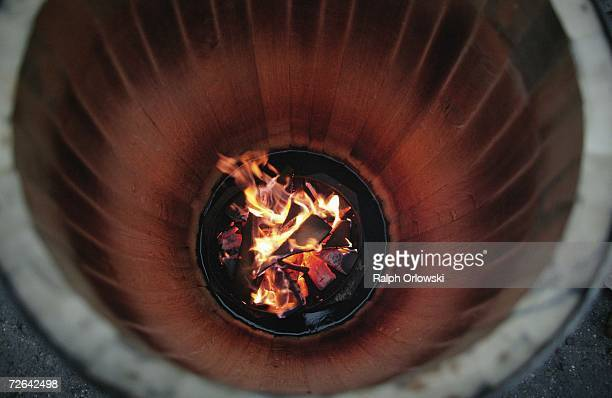 The inside of an oak wood barrel is toasted with a log fire at a cooper's workshop on November 25 2006 in Bad Duerkheim near Ludwigshafen Germany Oak...