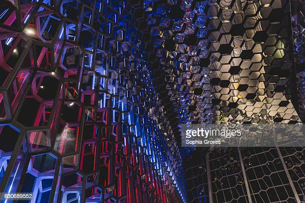 The inside of Harpa Concert Hall adorned with the colours of the Icelandic flag The building was designed by Henning Larsen Architects Batterid...