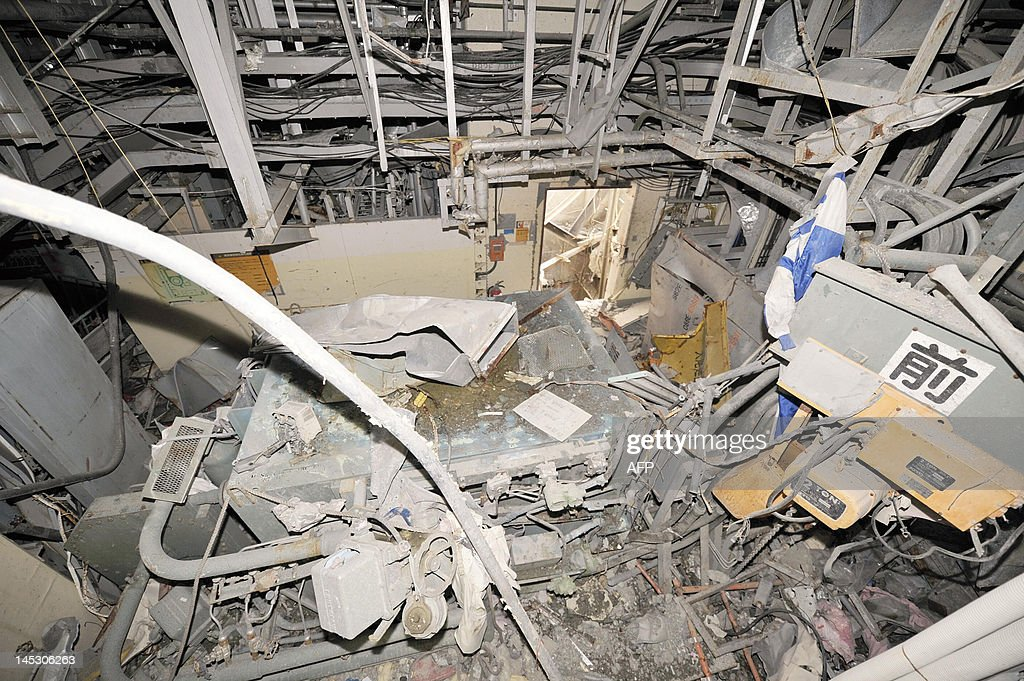 The inside of the No. 4 reactor building is seen at Tokyo Electric Power Co.'s (Tepco) Fukushima Dai-Ichi nuclear power plant in Okuma Town, Fukushima Prefecture on May 26, 2012. Japan may look to generating 15 percent of its electricity needs from nuclear power, a minister said, as the country seeks to rebalance its energy supply after the Fukushima disaster. JAPAN OUT AFP PHOTO / Toshiaki Shimizu / JAPAN POOL
