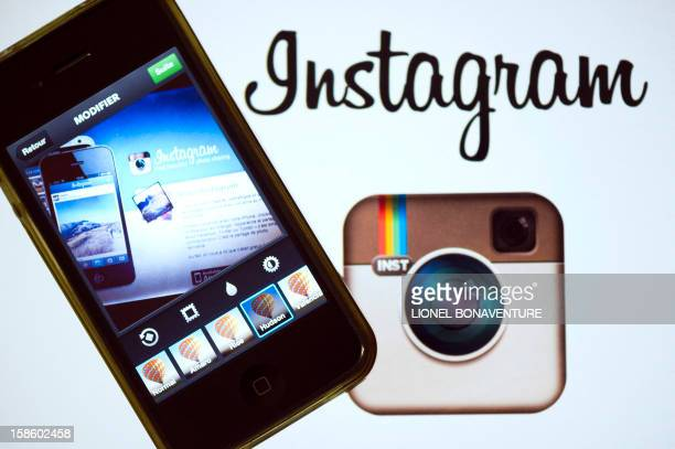 The Instagram logo is displayed next to a smartphone on December 20 2012 in Paris Instagram backed down on December 18 2012 from a planned policy...