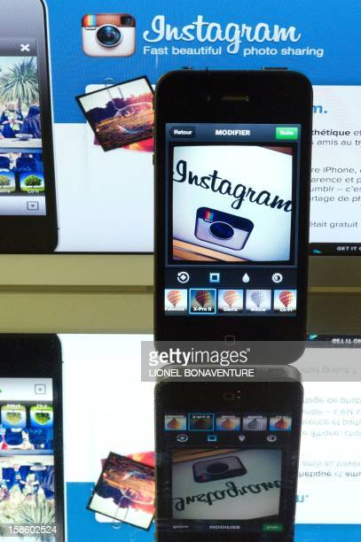 The Instagram logo is displayed on a smartphone and a tablet on December 20 2012 in Paris Instagram backed down on December 18 2012 from a planned...