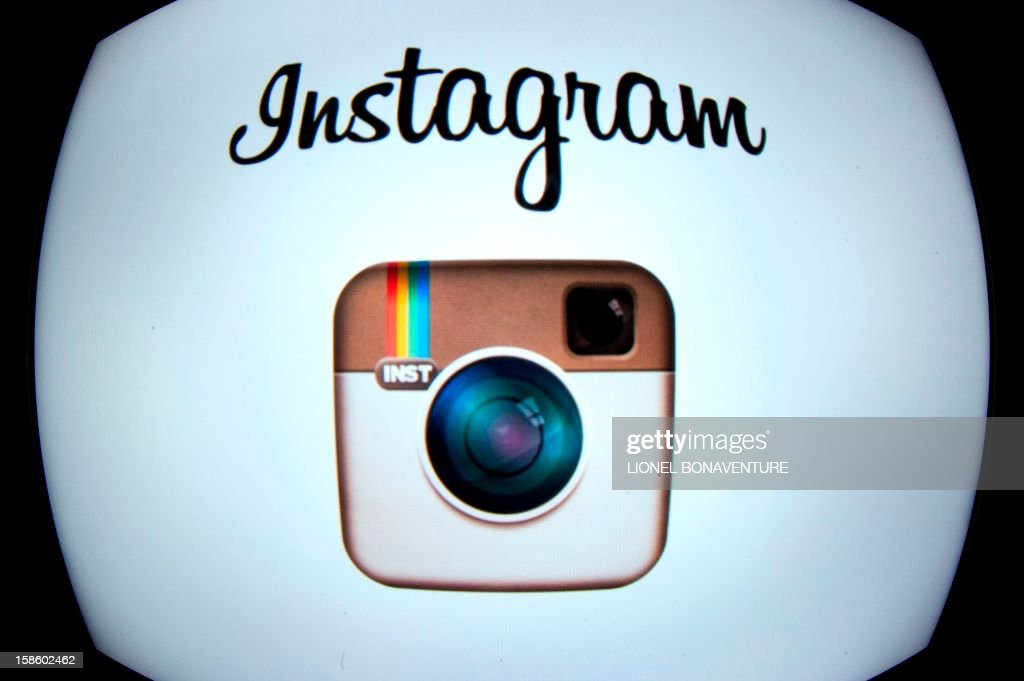 The Instagram logo is displayed on a tablet on December 20, 2012 in Paris. Instagram backed down on December 18, 2012 from a planned policy change that appeared to clear the way for the mobile photo sharing service to sell pictures without compensation, after users cried foul. Changes to the Instagram privacy policy and terms of service set to take effect January 16 had included wording that appeared to allow people's pictures to be used by advertisers at Instagram or Facebook worldwide, royalty-free. AFP PHOTO / LIONEL BONAVENTURE