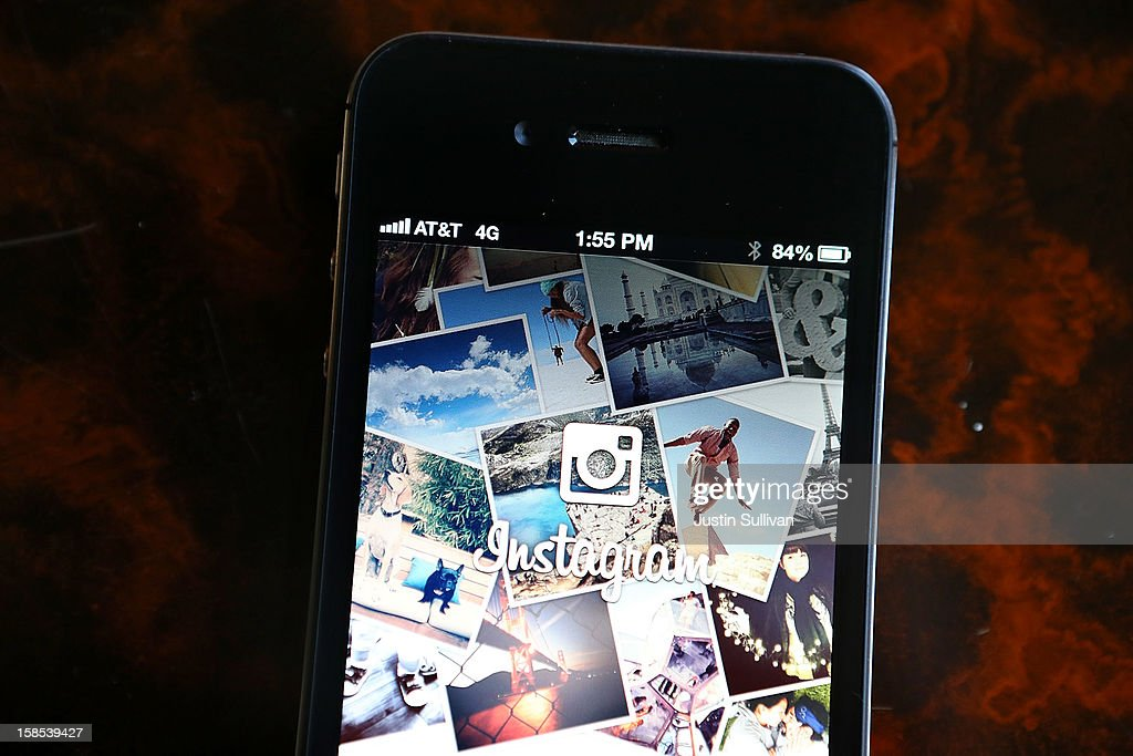 The Instagram logo is displayed on an Apple iPhone on December 18 2012 in Fairfax California Users of the popular photosharing app Instagram are...