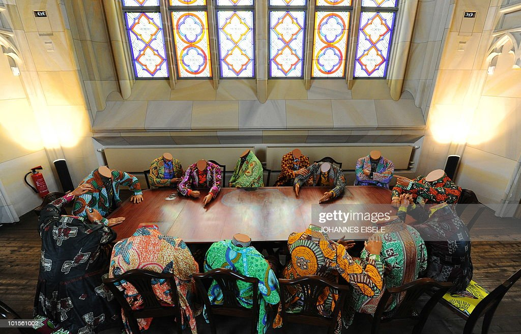 The installation 'Scramble for Africa' by British artist of Nigerian origin Yinka Shonibare is pictured during a press preview of the exhibition 'Who Knows Tomorrow' on June 02, 2010 at the Friedrichswerdersche Kirche in Berlin. The exhibition can be visited from June 4 till September 26, 2010.