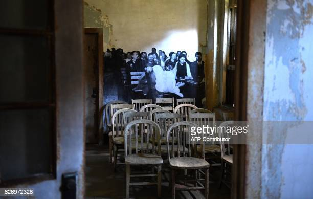 The installation Unframed Ellis Island by French artist JR is seen on display inside a room in one of the buildings of the The Ellis Island Hospital...