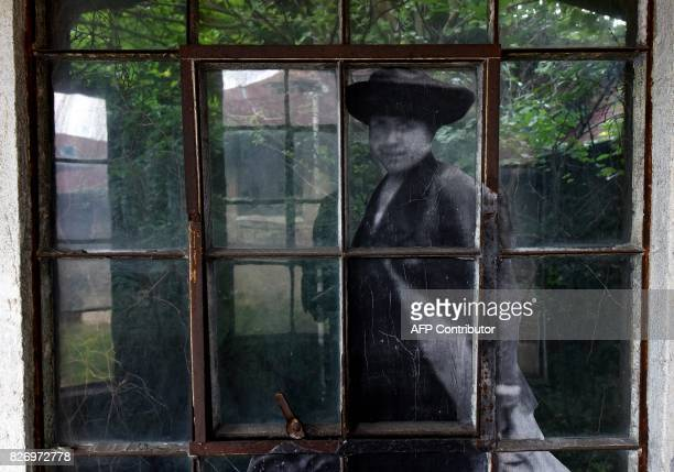 The installation Unframed Ellis Island by French artist JR is seen on display in a room in one of the buildings of the The Ellis Island Hospital on...