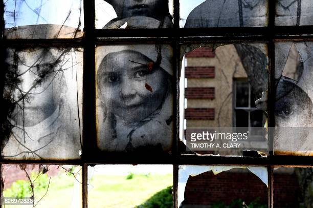 TOPSHOT The installation Unframed Ellis Island by French artist JR is seen on display in a room in one of the buildings of the The Ellis Island...