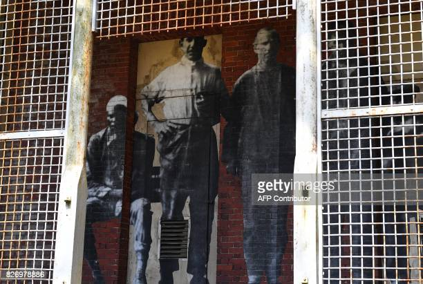 The installation Unframed Ellis Island by French artist JR is seen on display in one of the buildings of the The Ellis Island Hospital on August 5 a...