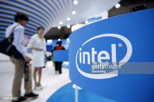 The Intel Corp logo is displayed at the company's booth at the CEATEC Japan 2013 exhibition in Chiba City Japan on Tuesday Oct 1 2013 CEATEC an...