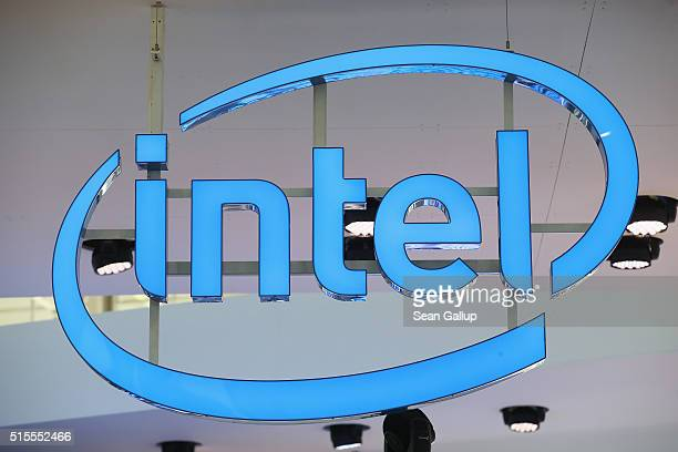 The Intel logo hangs over the company's stand at the 2016 CeBIT digital technology trade fair on the fair's opening day on March 14 2016 in Hanover...