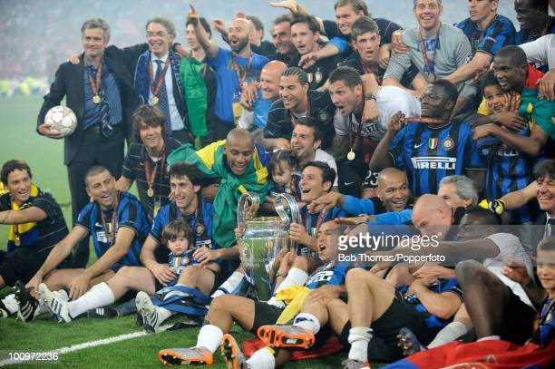 The Inter Milan team celebrate with the trophy including manager Jose Mourinho and President Massimo Moratti after winning the UEFA Champions League...