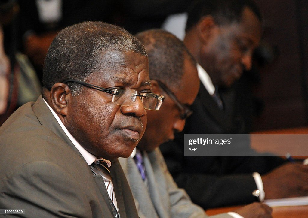 The interim president of ex-president Laurent Gbagbo's Ivorian Popular Front (FPI) party, Sylvain Miaka Oureto looks on during a meeting with Ivory Coast's Prime Minister and FPI leaders, on January 18, 2013 at the Prime Minister office in Abidjan.