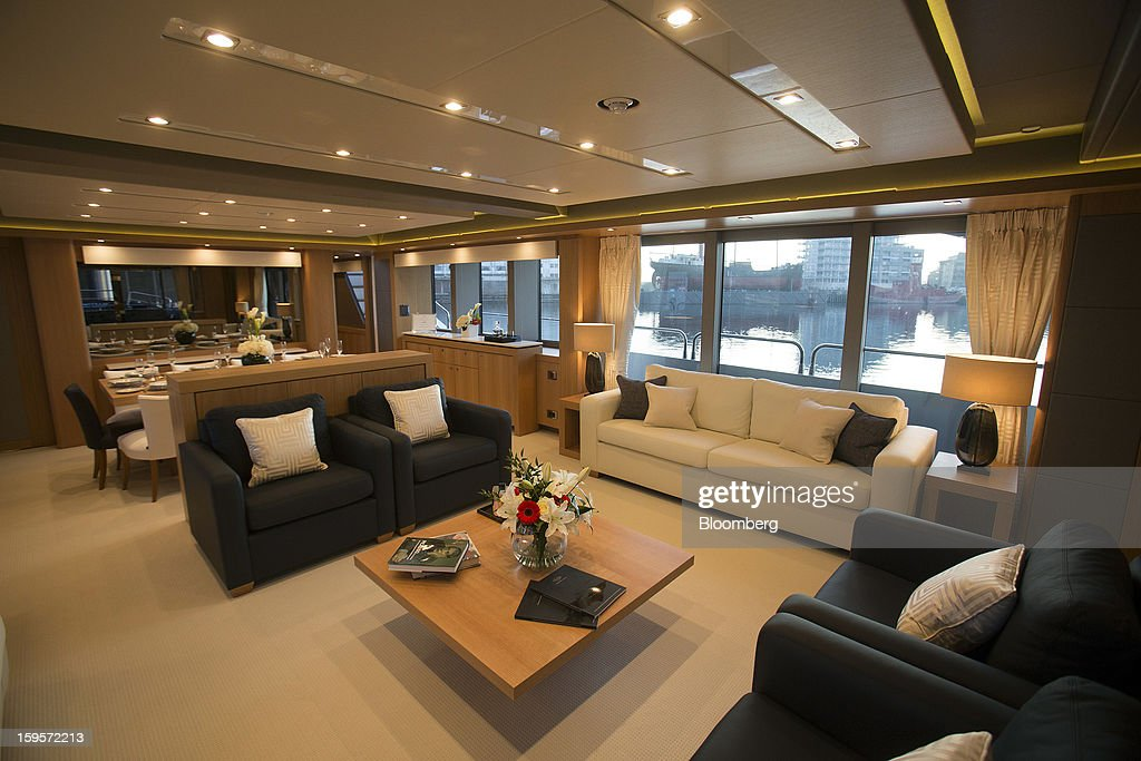 The interior living area aboard a Predator 115 luxury yacht, manufactured by Sunseeker International Ltd., is seen during the Tullet Prebon London Boat Show 2013 at the ExCeL center in London, U.K., on Wednesday, Jan. 16, 2013. The show, Europe's first in 2013, will showcase new sailing craft from dinghies to luxury yachts, and runs Jan. 12-20. Photographer: Simon Dawson/Bloomberg via Getty Images