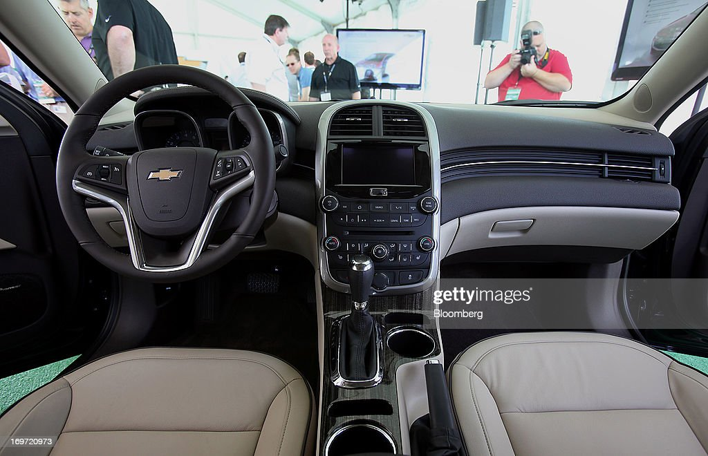 The interior of a 2014 Chevrolet Malibu is seen during the unveiling at the Belle Isle Grand Prix racetrack in Detroit, Michigan, U.S., on Friday, May 31, 2013. General Motors Co., after failing to gain sales with its redesigned Chevrolet Malibu last year, said it's developed an updated version of the mid-size sedan with a sportier front end, roomier back seat and better fuel efficiency. Photographer: Fabrizio Costantini/Bloomberg via Getty Images