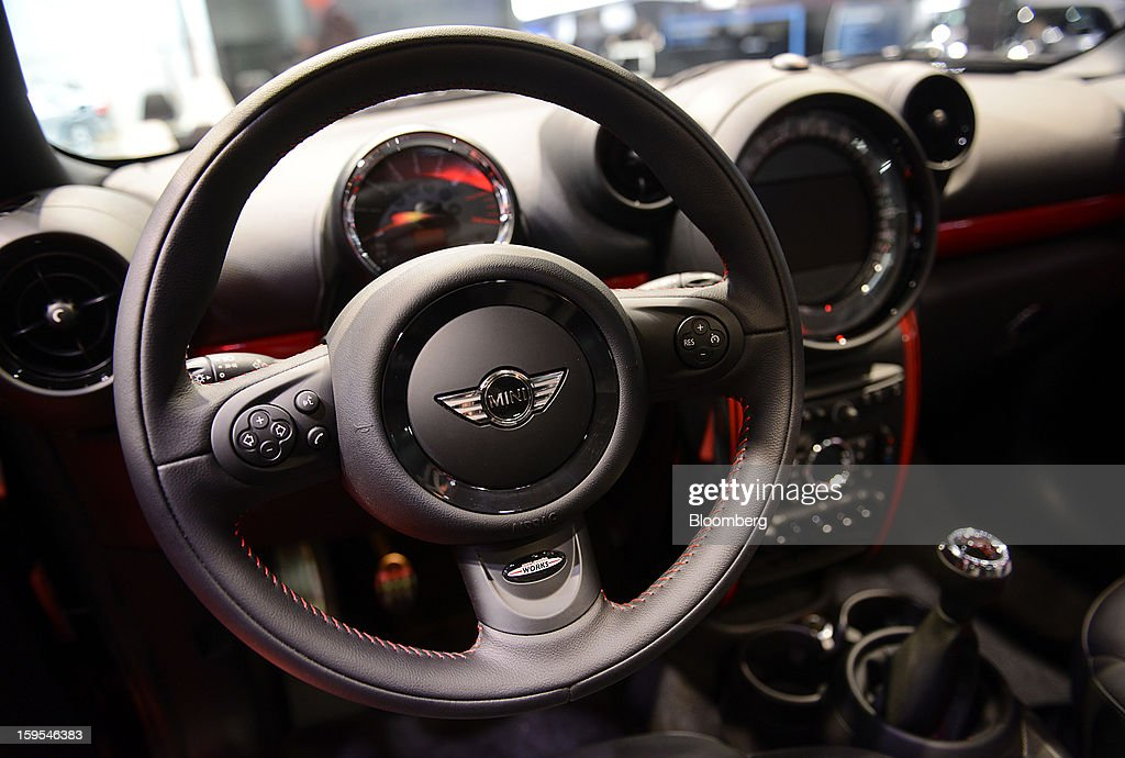 The interior of a Bayerische Motoren Werke AG (BMW) Mini Cooper vehicle is seen during the 2013 North American International Auto Show (NAIAS) in Detroit, Michigan, U.S., on Tuesday, Jan. 15, 2013. The Detroit auto show runs through Jan. 27 and will display over 500 vehicles, representing the most innovative designs in the world. Photographer: David Paul Morris/Bloomberg via Getty Images