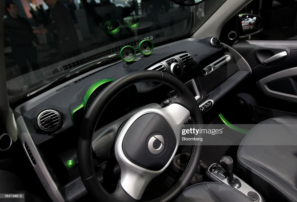 The interior of a Daimler AG Smart Car electric vehicle is seen at the company's booth during the 2013 New York International Auto Show in New York, U.S., on Wednesday, March 27, 2013. The 113th New York International Auto Show, which runs from March 29 to April 7, features 1,000 vehicles as well the latest in tech, safety and innovation. Photographer: Jin Lee/Bloomberg via Getty Images