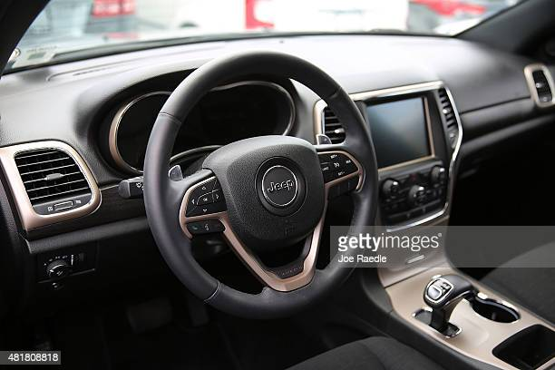 The interior of a Fiat Chrysler Jeep Grand Cherokee is seen on a sales lot as the company announced it is recalling about 14 million Dodges Jeeps...