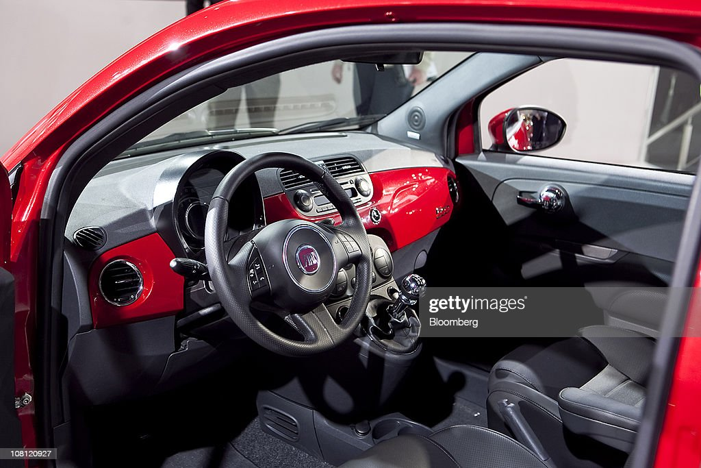The interior of a Fiat SpA 500 electric car sits on display during the North American International Auto Show (NAIAS) in Detroit, Michigan, U.S., on Wednesday, Jan. 12, 2011. The 2011 Detroit auto show runs through Jan. 23 and features more than 30 new vehicle premieres. Photographer: Keyur Khamar/Bloomberg via Getty Images